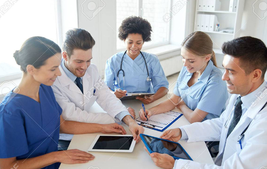 Doctor in front of her team